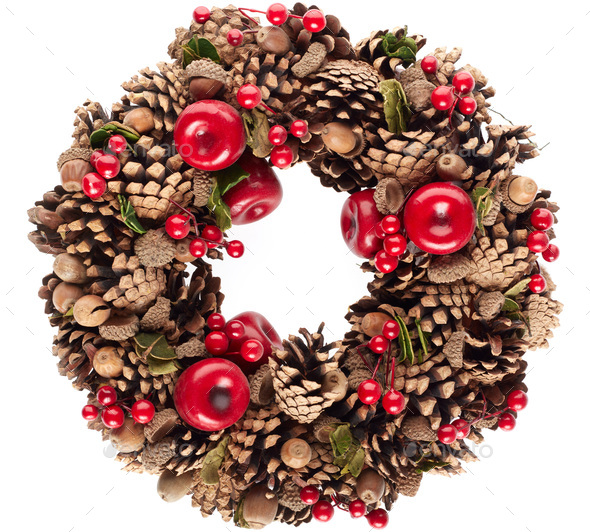 Christmas wreath with pine cones, red berries and acorns isolated on white background - Stock Photo - Images
