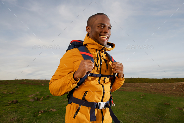 happy african american backpacker walking outdoor in nature - Stock Photo - Images