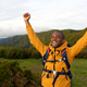 happy african american backpacker standing outdoors with arms raised - PhotoDune Item for Sale