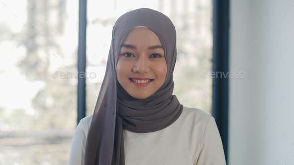 Portrait of successful beautiful executive businesswoman looking at camera and smile in office. - Stock Photo - Images