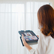 Young Asian business female using tablet video call talking with family at living room. - PhotoDune Item for Sale