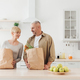 Happy family relationships, couple unpacking fresh products from market in kitchen - PhotoDune Item for Sale