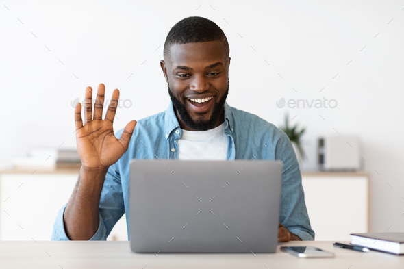 Video Call. Positive Young Black Guy Having Web Conference On Laptop - Stock Photo - Images