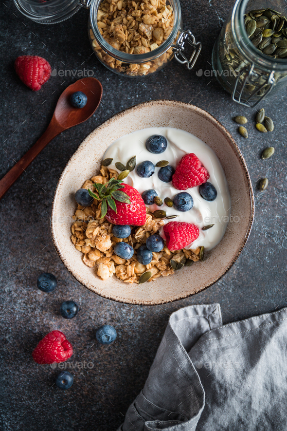 Healthy breakfast, cereal with berries and yogurt - Stock Photo - Images