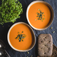 Vegetable creamy healthy soup with pumpkin seeds on a kitchen table. - PhotoDune Item for Sale