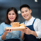 Secret ingredient is love. Beautiful young couple preparing a healthy meal together - PhotoDune Item for Sale
