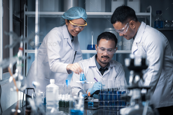 Team of Medical Research Scientists Collectively Working on a New Generation - Stock Photo - Images