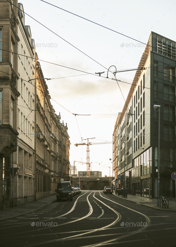 Tram tracks running through an emoty city - Stock Photo - Images