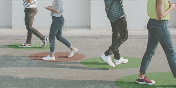 Young adults using smartphones as they are walking outdoors - Stock Photo - Images