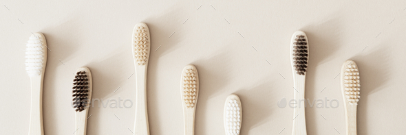 Bamboo toothbrushes on a beige background - Stock Photo - Images