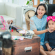 young woman and children girl living at home, work from home to make video online streaming - PhotoDune Item for Sale
