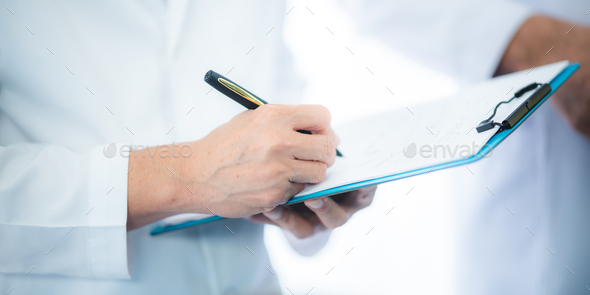 The doctor examines the patient's history in hospital or clinic, medicine health care - Stock Photo - Images