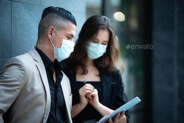 business people meeting with mask to prevent the spread of the virus covid-19 - Stock Photo - Images