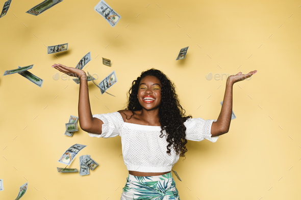 Happy woman spending money during her summer vacation - Stock Photo - Images