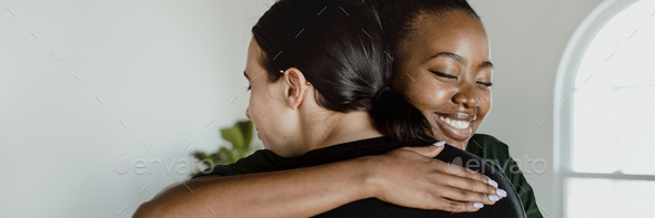 Women hugging each other - Stock Photo - Images
