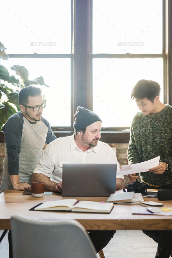 Diverse startup team discussing a project - Stock Photo - Images