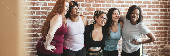 Happy women in a fitness studio - Stock Photo - Images