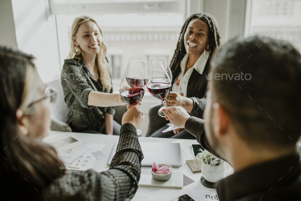 Professional business celebrating with wine - Stock Photo - Images