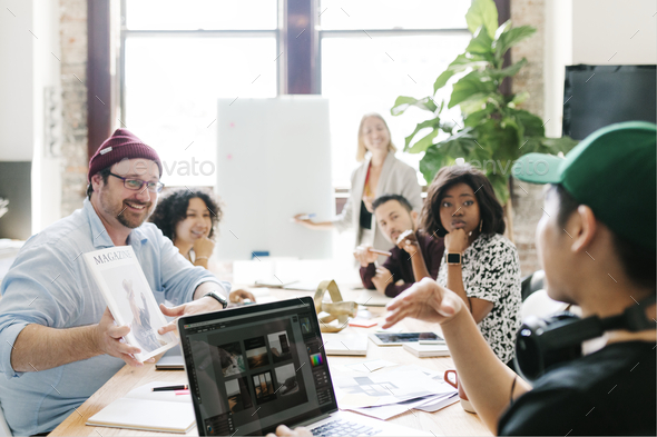 Graphic designer team working on a project - Stock Photo - Images