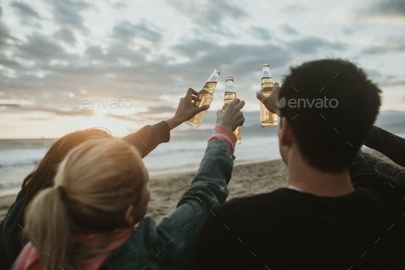 Friends drinking by the beach - Stock Photo - Images