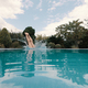 Slender girl dives into the pool - PhotoDune Item for Sale