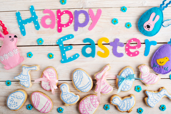 Handmade Happy Easter baking and sewing background on white wooden table flat lay view - Stock Photo - Images