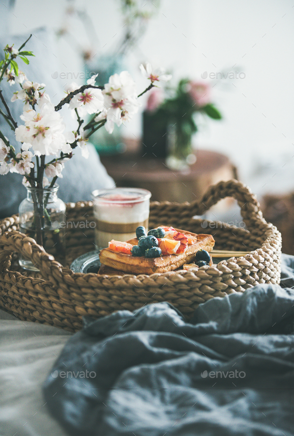 Waffles with blood orange and blueberries, rose latte coffee and blooming flower - Stock Photo - Images
