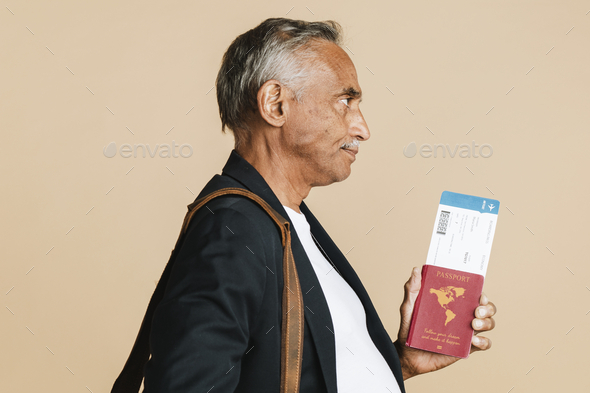 Senior mixed Indian man boarding the plane - Stock Photo - Images
