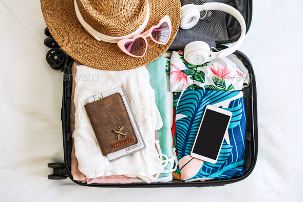 Traveler suitcase and luggage with smart phone ready for travel - Stock Photo - Images