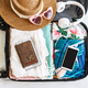 Traveler suitcase and luggage with smart phone ready for travel - PhotoDune Item for Sale
