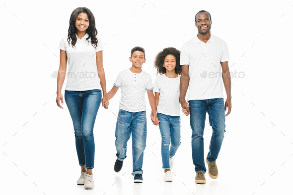 happy african american family holding hands while walking together isolated on white - Stock Photo - Images
