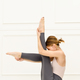 Supple fit woman doing an Ubhaya Padangusthasana variation pose - PhotoDune Item for Sale