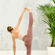 Fit flexible woman performing a variation of the Anantasana yoga - PhotoDune Item for Sale