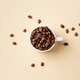 Coffee beans in cup on pastel - PhotoDune Item for Sale