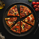 Pizza with salami and cheese on dark - PhotoDune Item for Sale