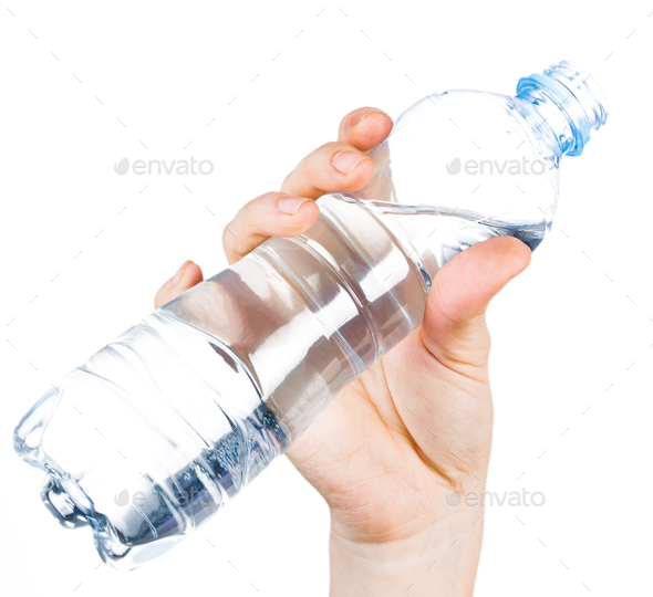 Open plastic bottle with water in a female hand on a white background, isolate - Stock Photo - Images