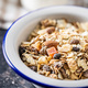 Beakfast cereals in bowl. Healthy muesli with oat flakes, nuts and raisins - PhotoDune Item for Sale