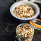 Beakfast cereals in jar. Healthy muesli with oat flakes, nuts and raisins - PhotoDune Item for Sale