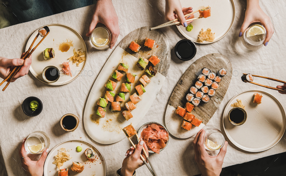 Family or friends having Japanese traditional sushi dinner at quarantine - Stock Photo - Images