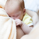 Baby eating breast milk. Concept of breast feeding. - PhotoDune Item for Sale