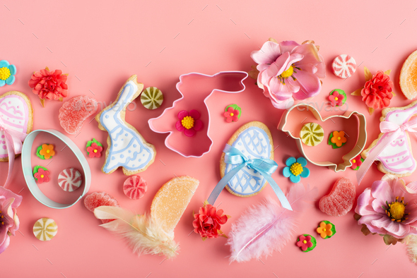 Easter frosted cookies in shape of egg chicken and rabbit, sugar sprinkles, candies, cookie cutters - Stock Photo - Images