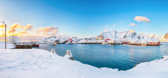 Astonishing winter view on Hamnoy village with port and snowy  mountain peaks  on background. - Stock Photo - Images