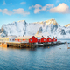 Traditional Norwegian red wooden houses (rorbuer) on the shore of  Reinefjorden near Hamnoy village. - PhotoDune Item for Sale
