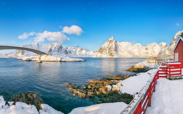 Fabulous winter view on Hamnoy village and bridge to Olenilsoya island. - Stock Photo - Images