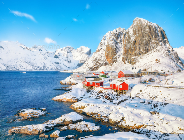 Picturesque winter view on Hamnoy village and Festhaeltinden mountain on background. - Stock Photo - Images