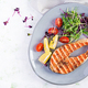 Salmon fish steak grilled and tomatoes salad with microgreens. - PhotoDune Item for Sale