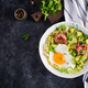 Fried egg, prosciutto, avocado and fresh salad. - PhotoDune Item for Sale