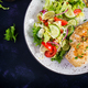 Fried chicken fillet and fresh vegetable salad of tomatoes, cucumbers and lettuce - PhotoDune Item for Sale