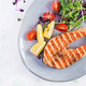 Salmon. Salmon fish steak grilled and tomatoes salad with microgreens. - PhotoDune Item for Sale