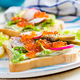 Sandwiches with salmon red caviar with sliced avocado and radish. Sandwich for lunch. Premium food - PhotoDune Item for Sale